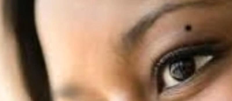 body mole on eyebrow