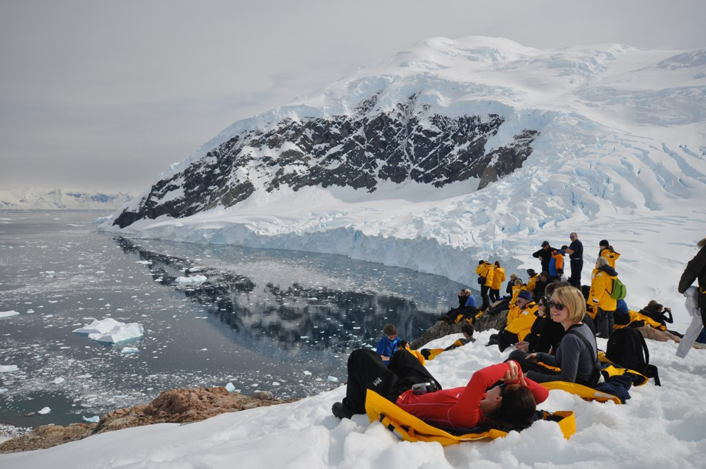 people sitting in snow in Antarctica
