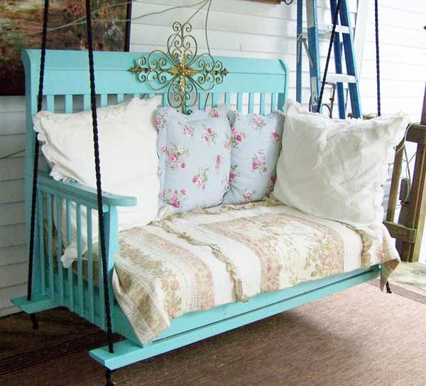 A baby crib can be remodeled to make an amazing porch swing.