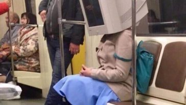 computer monitor taking the ride in a subway