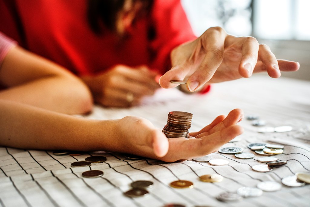 counting coins - Are You A Mature Adult? Let These 4 Signs Confirm That For You