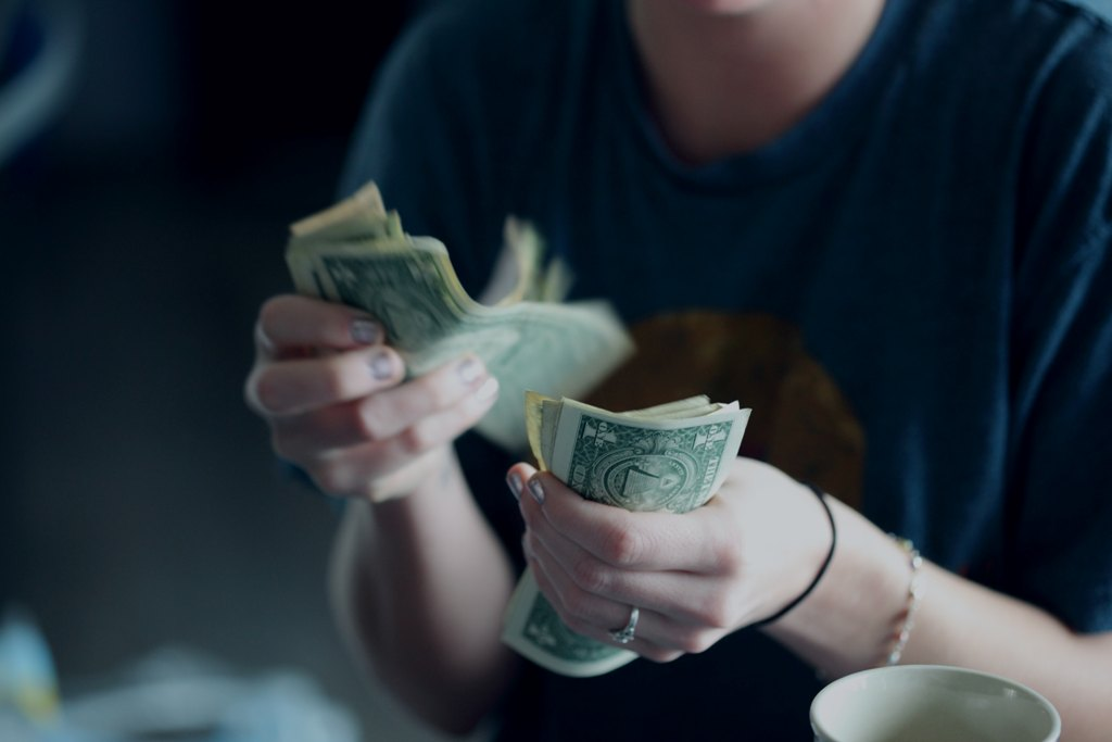 counting dollars - Are You A Mature Adult? Let These 4 Signs Confirm That For You