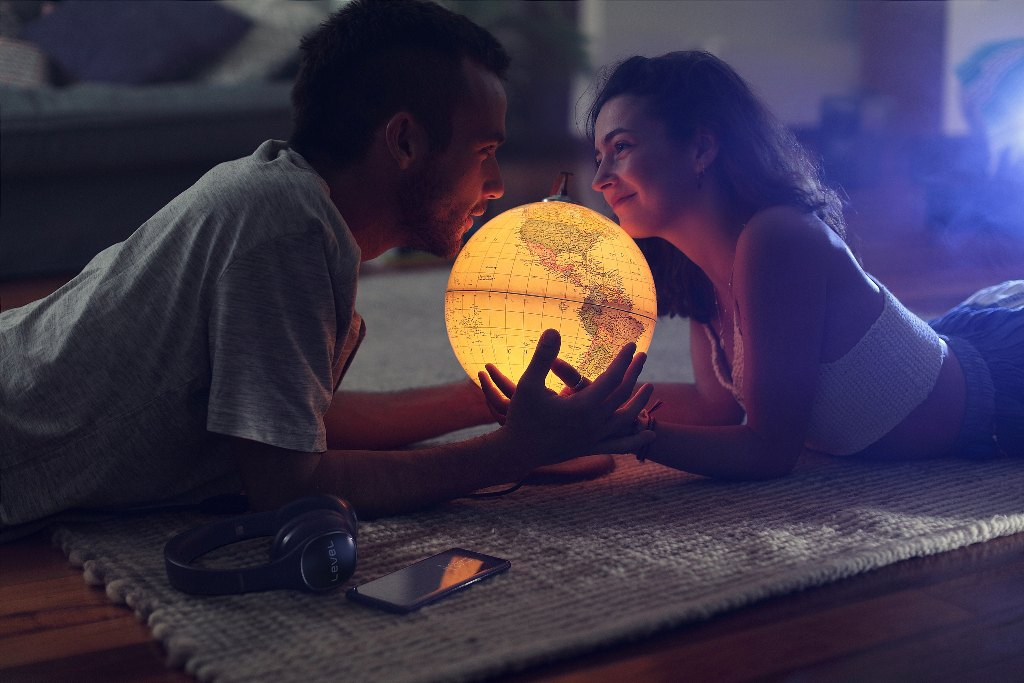 couple holding globe - 3 Flirting Tips That You Can Take From Babies