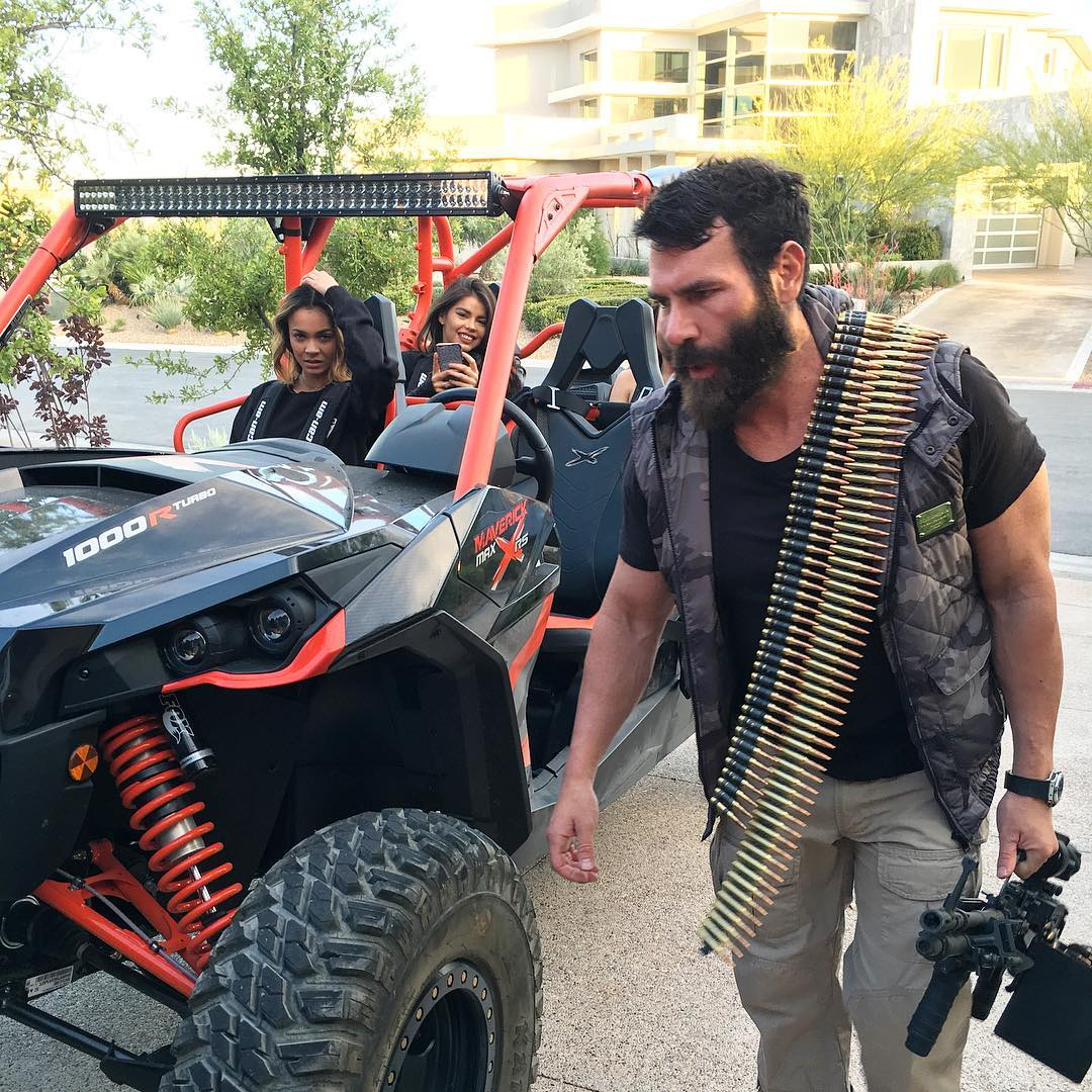 Dan Bilzerian carrying gun