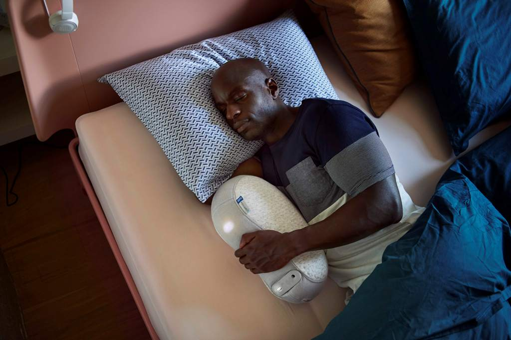man sleeping with Somnox Sleep Robot - Somnox Sleep Robot will help you sleep faster and feel relaxed