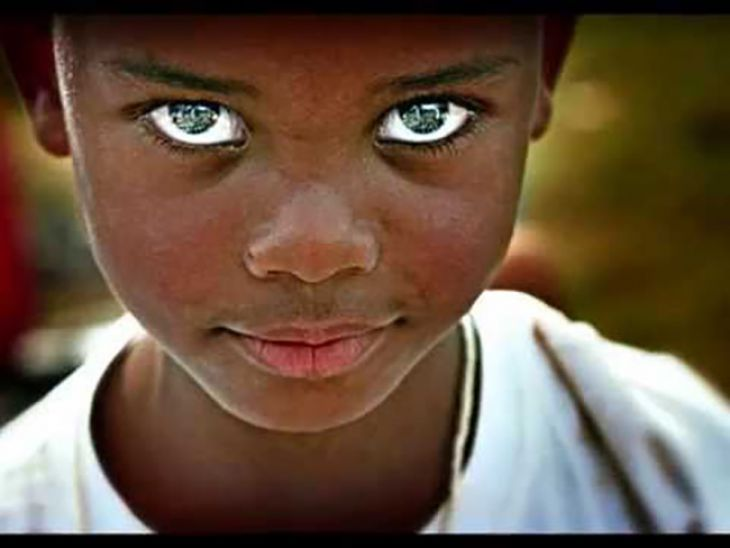 african kid with green eyes