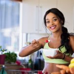 woman eating berries healthy Boost Your Immunity Naturally
