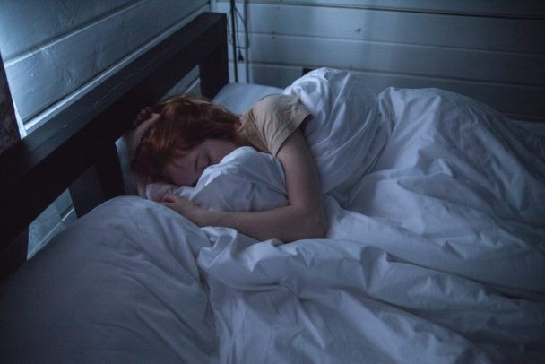 woman sleeping 1 608x406 - What Your Sleep Type Says About You